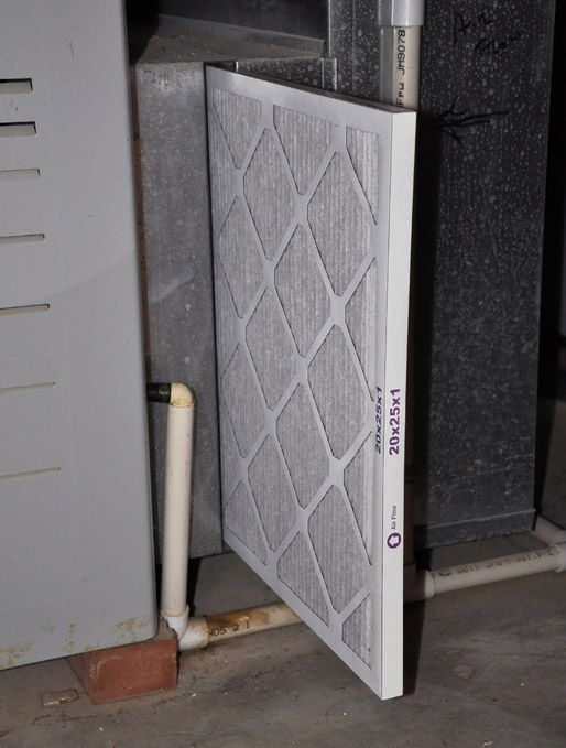 new furnace filter being installed