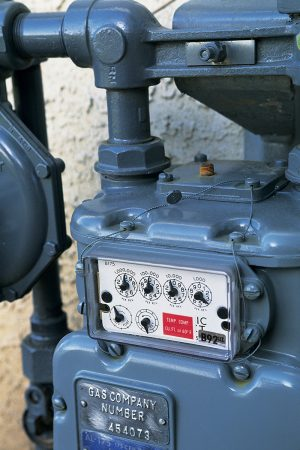 A gas meter located outside of a house