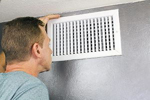 Person looking inside of a vent