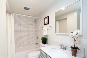 Bathroom with white tile and decor